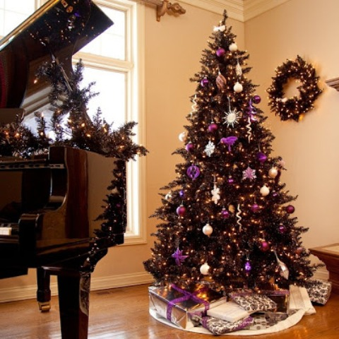 13-a-wreath-and-tree-in-black-is-chic-and-purple-adds-just-the-pop-of-color-to-this-living-room
