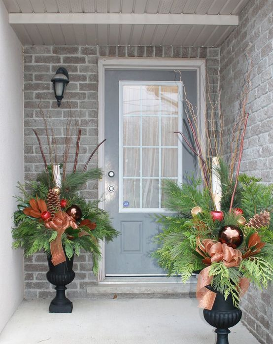 09-festive-urn-arrangements-with-greens-ornaments-and-pinecones