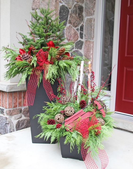11-containers-with-evergreens-vine-spheres-and-red-ribbon