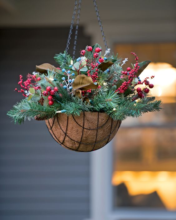 14-a-hanging-arrangement-with-evergreens-pinecones-berries-and-leaves