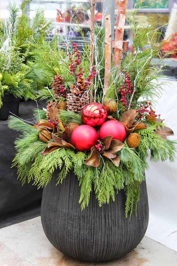 17-a-large-urn-evergreens-pinecones-berries-leaves-and-oversized-ornaments