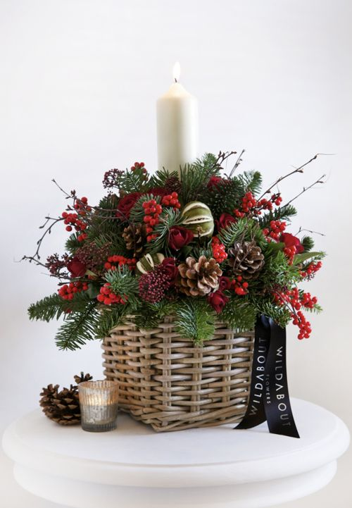 20-a-basket-arrangement-with-pinecones-berries-and-evergreens