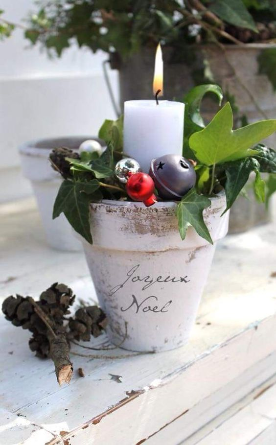 27-a-planting-pot-with-ornaments-and-a-candle