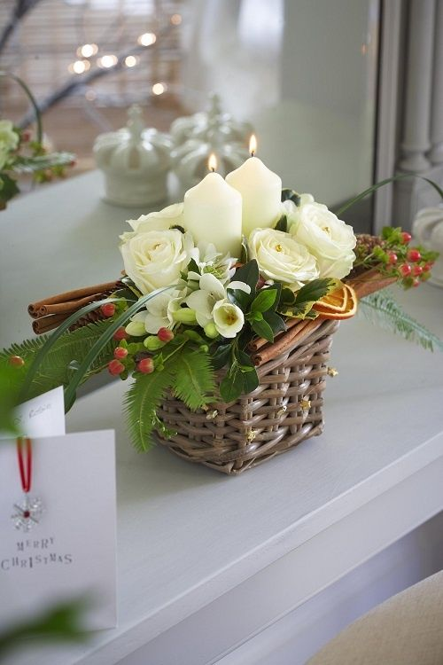 30-a-tiny-basket-arrangement-with-candles-flowers-and-cinnamon-sticks