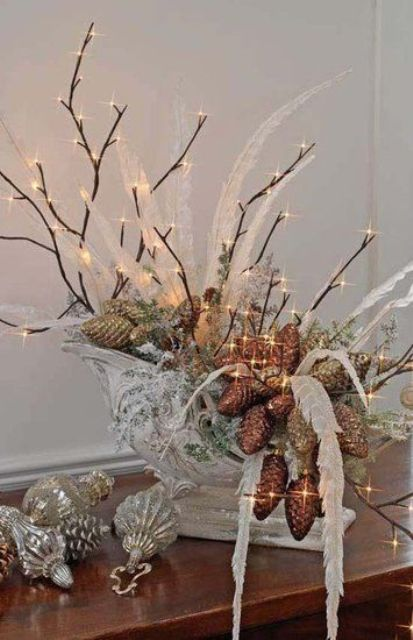 37-sleigh-filled-with-lighted-twigs-pinecones-feathers-and-ornaments