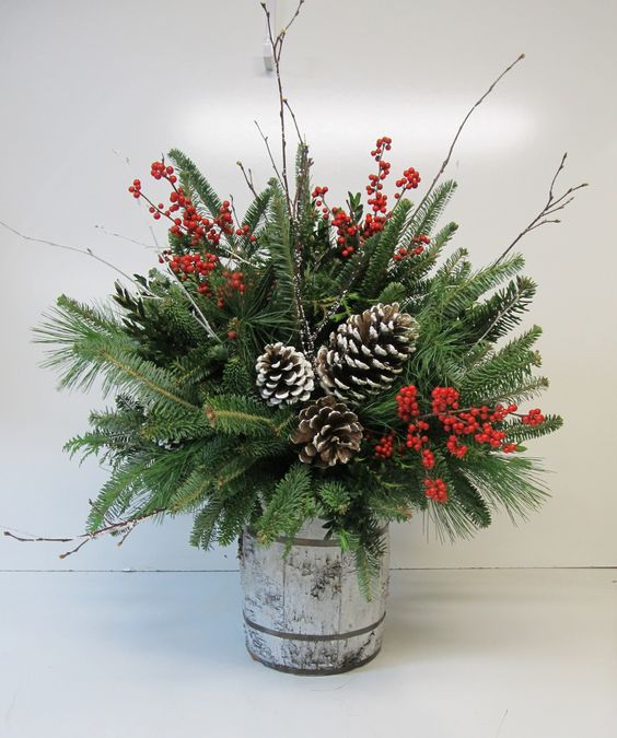 38-small-barrel-arrangement-with-evergreens-pinecones-and-berries