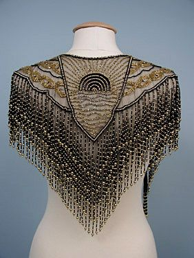 I love things like this! Look at that workmanship! Black & Gold Beaded Evening Collar, c. 1914: