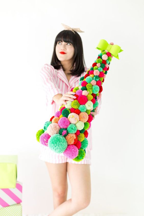 18 a bright and colorful pompom Christmas tree with a neon bow on top is a gorgeous idea for those who love colors