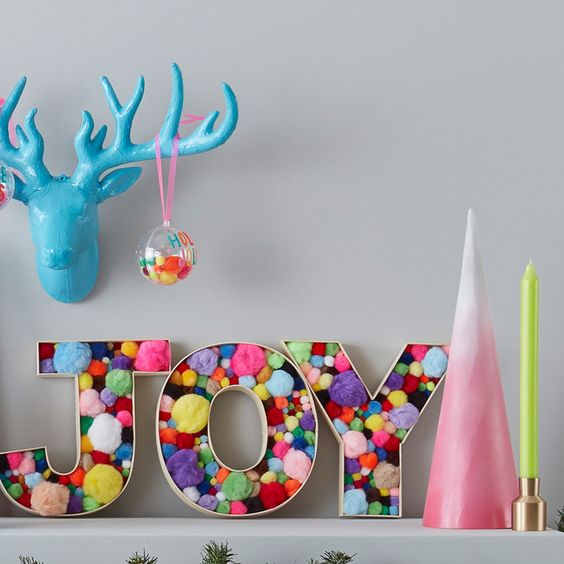 20 a fun and colorful Christmas decoration of letters filled with colorful pompoms of various sizes