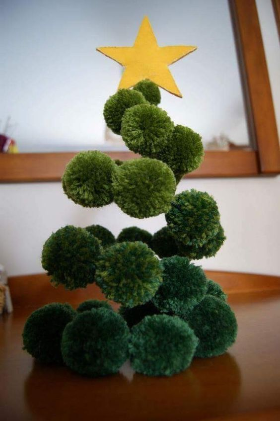 21 a fun green pompom Christmas tree made on wire with a gold felt star on top is a great alternative to a usual tree