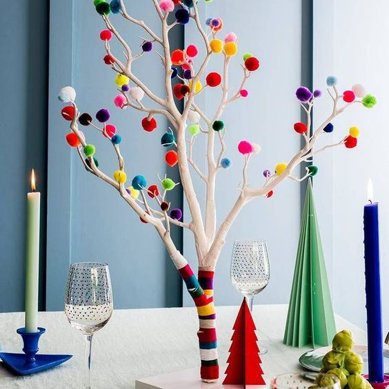 25 an alternative to a usual Christmas tree whitewashed branches with colorful washi tape and pompoms