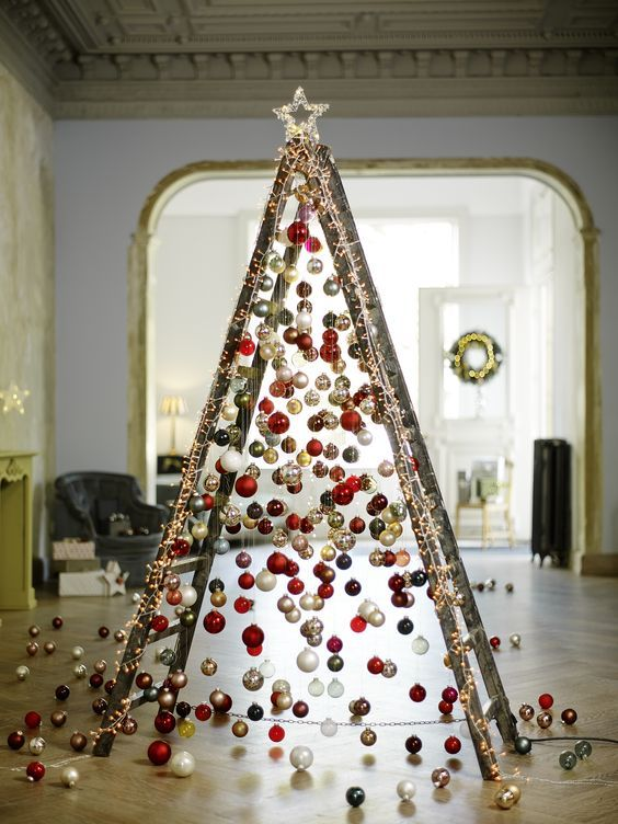 28 take a usual ladder and cover it with lights then attach Christmas ornaments on various heights to form a creative tree